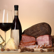 Exquisite still life of wine, cheese and meat products — Stock Photo #25410895