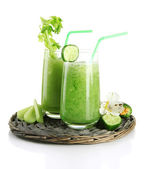 Glasses of green vegetable juice, isolated on white — Stock Photo