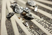 Beautiful shining crystals (diamonds) on money background — Stockfoto