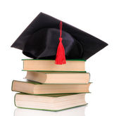 Grad hat with books isolated on white — 图库照片