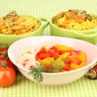 Delicious pilaf with vegetables on tablecloth background — Stok fotoğraf