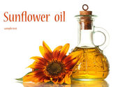Sunflower oil and sunflower isolated on white — Stock Photo