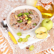 Stock Photo: Useful oatmeal in bowl with fruit on wooden table close-up