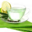 Transparent cup of green tea with lemon on napkin, isolated on white — Stok fotoğraf