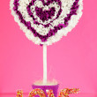 Decorative heart from paper on pink background — Stok fotoğraf