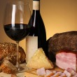 Exquisite still life of wine, cheese and meat products — Stock Photo #25451777