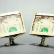 Dollars folded into computer monitors on grey background — Stock Photo