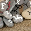 Stock Photo: Fortune telling with symbols on stones on burlap background