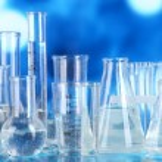 Test tubes on blue background — Stock Photo