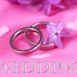 Beautiful wedding rings on pink background — Foto de stock #25454381