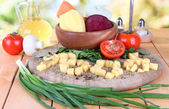 Composition of vegetables on plate on nature background — Stock Photo