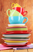 Mountain colorful dishes on napkin on wooden background — Stock Photo