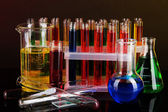 Colorful test tubes on dark background — Stock Photo