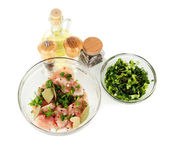 Chicken meat in glass bowl,herbs and spices isolated on white — Stock Photo