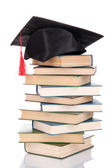 Grad hat with books isolated on white — Stock Photo