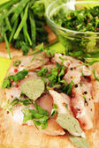 Chicken meat in glass plate,herbs and spices close-up — Stock Photo