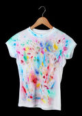 Bright t-shirt isolated on black — Stock Photo