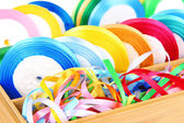 Bright silk ribbons in wooden box, close up — Stock Photo