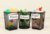 Buckets for waste sorting on room background — Stock Photo