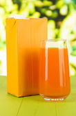 Juice pack on table on bright background — Stock fotografie
