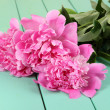 Beautiful peonies on table close-up — Stock Photo