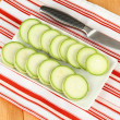 Stock Photo: Fresh marrows on plate, on wooden background