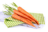 Carrots on cutting board, isolated on white — Stock fotografie