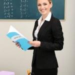 Portrait of teacher woman near chalkboard in classroom — Stock Photo #25522299