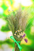 Bouquet of wild flowers and herbs, on bright background — Stock Photo