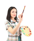 Beautiful young woman painter with brushes and palette at work, isolated on white — Stock Photo