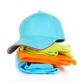 Blue peaked cap with T-shirts isolated on white — Stock Photo