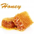Sweet honeycombs isolated on white - Stock Photo
