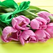 Beautiful bouquet of purple tulips on green wooden background — Stock Photo #25538135
