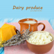 Dairy products on table on blue background — Stock Photo