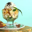 Fruit salad in a sundae dish on a blue background — Stock Photo