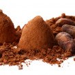 Chocolate truffles and cocoa isolated on white - Stock Photo