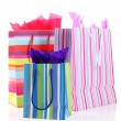 Striped shopping bags isolated on white — Stock Photo