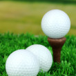 Golf balls on grass outdoor close up - Stock Photo