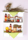 Variety spices on kitchen shelves — Stock Photo