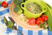 Diet soup with vegetables in pan isolated on white — Stock Photo