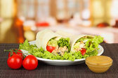 Kebab - grilled meat and vegetables, on plate, on wooden table, on bright background — Stok fotoğraf
