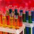 Colorful test tubes on bright background — Stock Photo #25540055