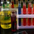 Colorful test tubes on bright background — Stock Photo #25540081