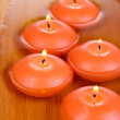 Beautiful candles in water close-up - Stock Photo