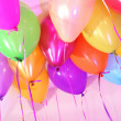 Many bright balloons under ceiling close-up — Stock Photo #25540343