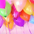 Many bright balloons under ceiling close-up — Stock Photo