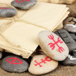Fortune telling  with symbols on stones on burlap background - Foto de Stock