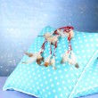 Beautiful dream catcher and pillows on blue background — Stock Photo