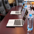 Stock Photo: Empty conference room with laptops on table