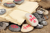 Fortune telling with symbols on stones on burlap background — Stock Photo